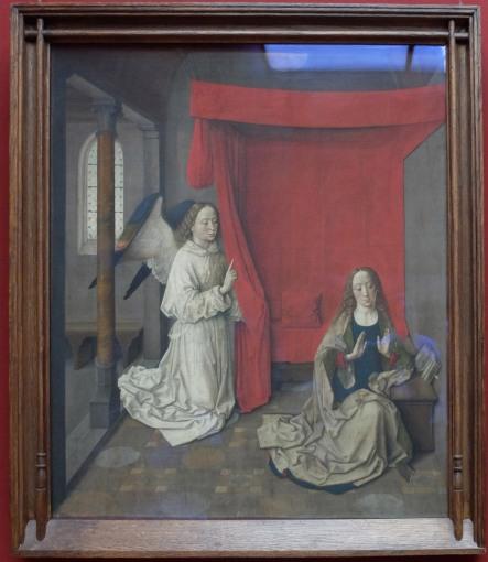 """Dieric Bouts, """"L'Annonciation"""", 1450 : le tableau est exposé sur un mur rouge qui le met encore plus en valeur."""
